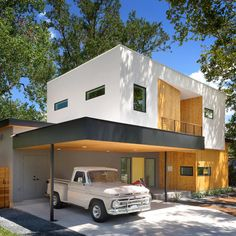 Matt Fajkus Architecture has completed a family residence in Austin with facades wrapped in cedar and stucco and punctuated with different-sized windows.