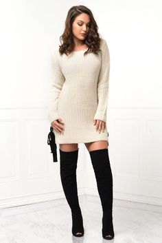 FREE SHIPPING OVER $75 & FREE RETURNS ON US ORDERS Chunky knit constructs this cozy sweater dress with rounded neckline an oversized, straight-cut bodice with a straight bottom hem and side adjustable