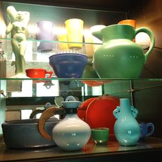 Catalina Island Pottery, a Gladding McBean Carafe, and a Metlox Pottery Vase from the 1930s.