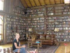 This picture was taken in a giant barn in the front yard of a Michigan farmhouse.  The family I used to nanny for spent weekends and holidays here.  It was one of the most amazing spaces I've ever been in.  Beautiful wood, books from floor to ceiling, a lofted, cozy bedroom, and much more.  LOVE LOVE LOVE!