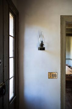 Full of original texture, the front hall needs no more adornment than a simple antique lantern.