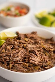 This EASY homemade barbacoa recipe makes fall-apart tender beef that's perfect for tacos, burritos, and sandwiches.