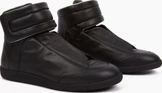 Maison Margiela Black Leather Future Hi-Top Sneakers The Maison Margiela Leather Future Hi-Top Sneakers, seen here in black. - - Maison Margiela present their unique take on a classic athletic silhouette for AW16, with this characteristically pared-back http://www.comparestoreprices.co.uk/january-2017-6/maison-margiela-black-leather-future-hi-top-sneakers.asp