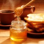 Putting honey in coffee