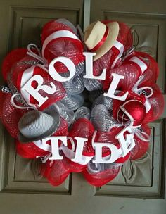 """This is a 24"""" hand crafted University of Alabama deco mesh """"Roll Tide"""" wreath. This wreath is accented with a houndstooth hat, a Bama football helmet and a Saban hat. ALL custom wreaths and hand paint"""