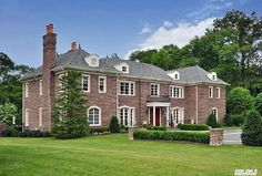 Majestic brick colonial 12,000 sf with finished basement on 4 manicured acres with oversized pool, pool house  and professional outdoor kitchen. Special features include a movie theater, wine cellar with tasting room, smart home technology and generator. Old Brookville, NY   Douglas Elliman elliman.com