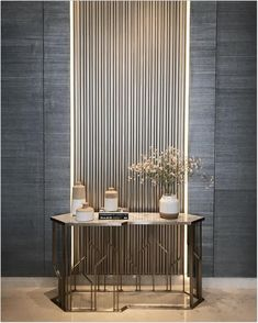 Contemporary console tables are essential to design pieces in any modern interior. This modern furniture is often found in entryways and hallway, the support fo Lobby Interior, Interior Walls, Interior Design Living Room, Interior Decorating, Luxury Home Decor, Luxury Interior, Modern Interior Design, Console Design, Flur Design