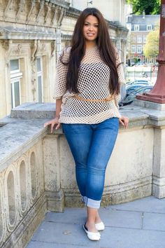 Best Pants For Curvy Women With Big Bump | Trendy Plus Size Womens Clothing Thick curvy woman with light blue jeans that hug her shape of her legs and fit around behind and waist nicely