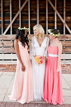 bridesmaids in long peach and coral bridesmaid dresses | photo by @anna Marinovich