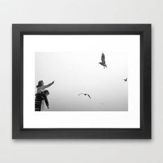 Feeding Gulls Framed Art Print by Regina Hoer - $35.00  #kids #gulls #misty #mist #blackandwhite #bw #photography #children #animals #birds