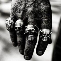skull rings on biker hand