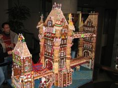 This is one spectacular gingerbread construction. Wouldn't it be fun to have gingerbread houses to use as decorations at a winter wedding? Check out the site for some unique gingerbread houses. (I can't pull this off but a bridge is a fun idea! Gingerbread House Pictures, Gingerbread Castle, Christmas Gingerbread House, Gingerbread Cookies, Christmas Cookies, Christmas Holidays, Christmas Houses, Christmas Baking, Xmas