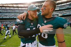 Carson Wentz #11 of the Philadelphia Eagles gets a hug by Zach Ertz #86 after…
