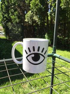 A personal favorite from my Etsy shop https://www.etsy.com/listing/601967850/im-watching-you-eye-12oz-coffee-mug
