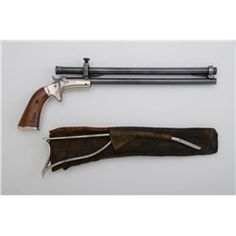 J. Stevens tip-up single shot target pistol with scope, skeleton stock and leather sheath for the