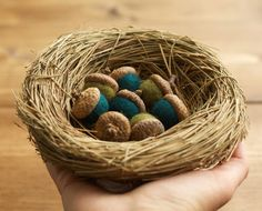 A set of 8 felted acorns gently resting in a nest of woven grass. A lovely centerpiece for your wedding, baby shower, or birthday celebration.