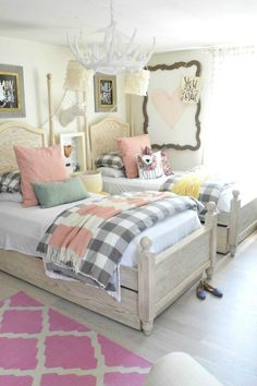 Love the buffalo check paired with pink in this shared girls bedroom