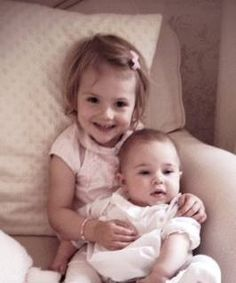 New photo of Princess Estelle and Princess Leonore (Facebook). Little Princess Leonore looks a little like her Daddy. I LOVE these sweet cousin pics.