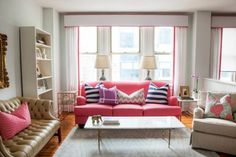 simple living room with pink couch