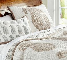 Lynette Paisley Reversible Quilt and Sham -  ancient art of block printing.     Made of pure cotton.     Hand quilted.     Quilt and sham reverse to a small paisley pattern in multitoned blue and beige.