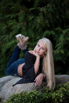 blonde girl wearing black top and jeans