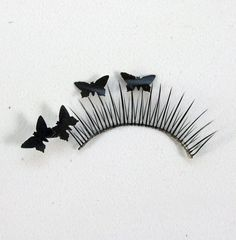 DIY Paper Butterfly Lashes ...Buy cheap false lashes.Look for a craft punch too. We've used a small butterfly punch to punch out butterfly shapes from black paper, which we then glued to the lashes.