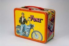 """Happy Days"" Lunch Box: ""Happy Days"" ran from 1974-1984 on ABC, with the Fonz as its breakout star. The Fonz became a cultural touchstone, with his trademark ""Aaay!"" and the turn of phrase ""jumping the shark,"" entering into the American lexicon."