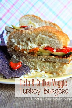 Feta & Grilled Veggie Turkey Burgers - savory turkey burgers piled high with marinated grilled zucchini and peppers, and served over toasted rolls!