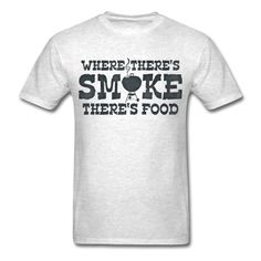 """Funny design for BBQ and grill masters with chalk board colored text that says WHERE THERE'S SMOKE THERE'S FOOD with a barbecue grill for the """"O"""" in smoke"""". PinkInkArt original!"""