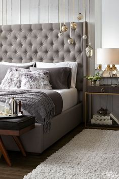 A neutral palette of greys, taupes and crisp whites, layered with textured knit throws and plush furry accents, create an elegant yet inviting master bedroom. Featured Products: Madrid Queen Bed, Tyler Table Lamp, International Lux Side Table, 300 Thread Count Queen Sheet Set, Mongolian Sheepskin Accent Pillow - Dip Dye Grey, Throw Blanket, Arlo Bench, Alpaca Area Rug