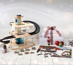 Shop the Bentley wooden toy garage - a traditional children's toy for toddlers, complete with turntables, heliport, elevator and fuel pump. Order from the official Bentley Collection website today. Wooden Toy Garage, Wooden Toys, Bentley Logo, Automobile, Design Language, Diamond Pattern, Toddler Toys, Deco, Turntable