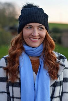 Winter style: Black and white checked coat, blue scarf