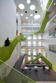 a green fibre-cement staircase spirals round the central atrium leads to common meeting facilities and a roof terrace with a beautiful view of the Horsens Fjord