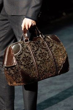 I'm thinking new style-carry crap to court in carpet bag. Screw the rumors anyway!!!!!  Get a life people!!!!