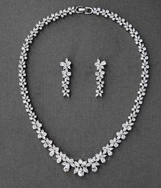 A bridal necklace set with classic styled marquise and teardrop CZ jewels. Earrings are approximately inches long, post backs, the necklace is 16 inches with a locking clasp. Grade AAA CZ, rhodium or rose gold plated, nickel and lead free. Diamond Solitaire Necklace, Diamond Pendant, Diamond Jewelry, Silver Jewelry, Fine Jewelry, Silver Ring, Dimond Necklace, Gold Jewellery, Silver Earrings
