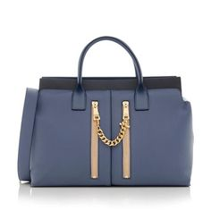 A recent addition to the Chloe Collection, the Cate satchel features a refined, elegant design. It is made from grained blue calfskin with smooth black leather details and gold-tone hardware. Features include two rolled handles, two front pockets, a zip closure, and fully lined interior with two open pockets. Wear this style on the forearm or over the shoulder with a detachable strap.