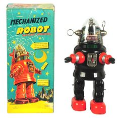 "April 19 & 20 Auction. Tin Litho C-Celled Mechanized Robby Robot. Japanese. Made by Nomura. Battery-operated and working. Short version. Includes original box. Toy has some minor wear around battery door and four small tabs on side strip professionally replaced. On this version, the doors ""snap"" shut rather than turn, rare variation of this toy. Box has one original insert. #Robot #Japanese #Nomura #MorphyAuctions"