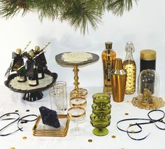 Green, gold and brass bar setup. Such fun decor for a wedding party