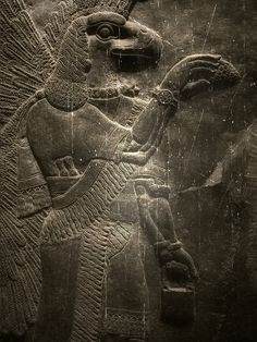 A figure of eagle-headed being from the palace of Sargon (around 700 BC)