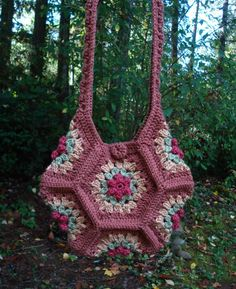 Posy Patch Bag - - A crochet pattern from Nancy Brown-Designer. This posy patch bag is such fun to make with just seven granny square hexagons. Slip stitch the hexagons together, crochet a button and add a shoulder strap and you have a unique bag t Crochet Purse Patterns, Bag Crochet, Crochet Shell Stitch, Granny Square Crochet Pattern, Crochet Handbags, Crochet Purses, Crochet Squares, Love Crochet, Crochet Granny
