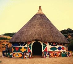 Photo about A beautiful colorful traditional ethnic African round hut of the Ndbele tribe in a village in South Africa in the peaceful evening sun. Image of game, cabin, clay - 2403495 African Hut, African Style, Mud House, House Floor, Afrique Art, Vernacular Architecture, Pavilion Architecture, Cultural Architecture, Sustainable Architecture