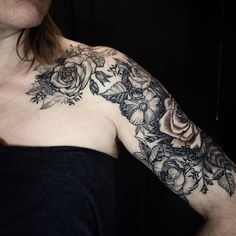 Etching or Woodcut blackwork tattoo, Mainly roses and smaller vintage looking botanical floral pieces. This shoulder and arm tattoo is also a cover up. By Riki-Kay Middleton rikikaytattoo@gmail.com based out of a private studio in Guelph Ontario Canada