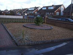 Gravel Driveway, with circle feature, block paving path and raised kerb edgings, Kirkby Liverpool  http://www.abellandscapes.co.uk/driveways-liverpool/driveway-projects/gravel-driveway-kirkby
