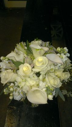 Calla lilies, day lilies, roses and hydrangea oh my! What a beautiful white wedding bouquet! americasflorist.com