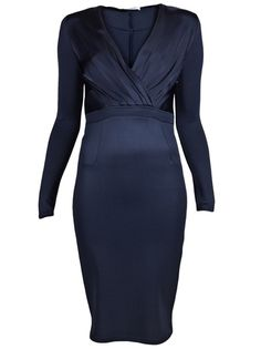 Long sleeve dress in navy from Givenchy. This stretch jersey shift dress features a a V-neck, cross-over pleated top, fitted waistband, and fitted pencil skirt. Has side concealed zipper closure.