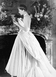 Model wearing a gown by Christian Dior in a 1949 photo by Willy Maywald for ELLE magazine