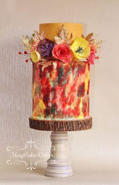 Autumn wedding cake. Flowers and leaves are made of wafer paper. The bottom tier is hand-painted using candy colour by MayBakesCakes.