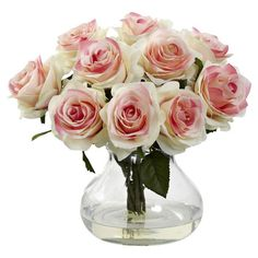 Create a lush tablescape or charming vignette with this lovely faux rose bouquet, nestled in a glass vase.  Product: Faux floral...