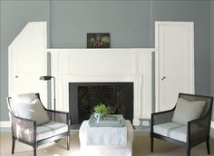 Look at the paint color combination I created with Benjamin Moore. Via @benjamin_moore. Wall: Puritan Gray HC-164; Door & Mantle: Simply White OC-117.