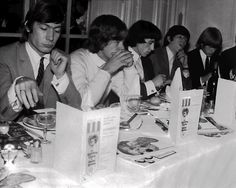 The Rolling Stones eat lunch at London's Savoy Hotel September 12, 1964. From left are Charlie Watts, Mick Jagger, Bill Wyman, Keith Richards and Brian Jones. (AP Photo)